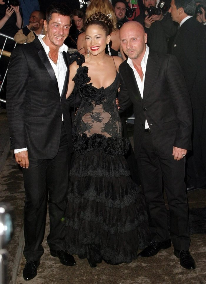 The Sicilian design duo Domenico Dolce (R) and Stefano Gabbana (L) posing with Jennifer Lopez at the 2004 Met Gala