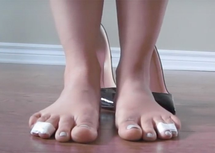 A screenshot from Maison Olomi's YouTube channel showing how to tape third and fourth toes to relieve pressure from the soles of the feet