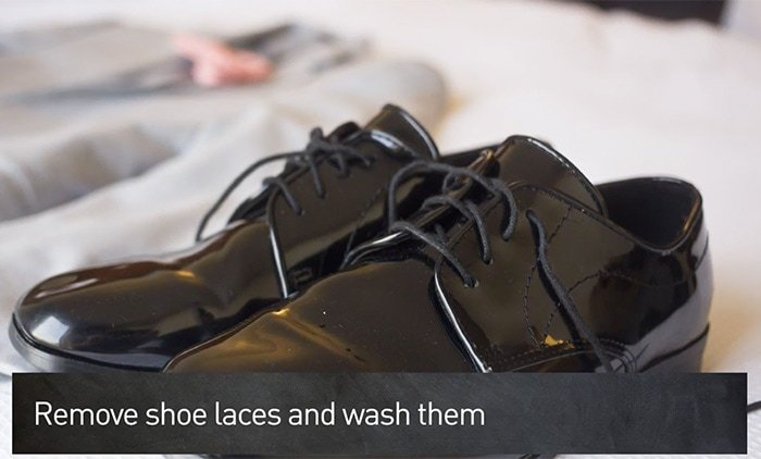 Remove the laces and run them through the washing machine if dirty or replace them
