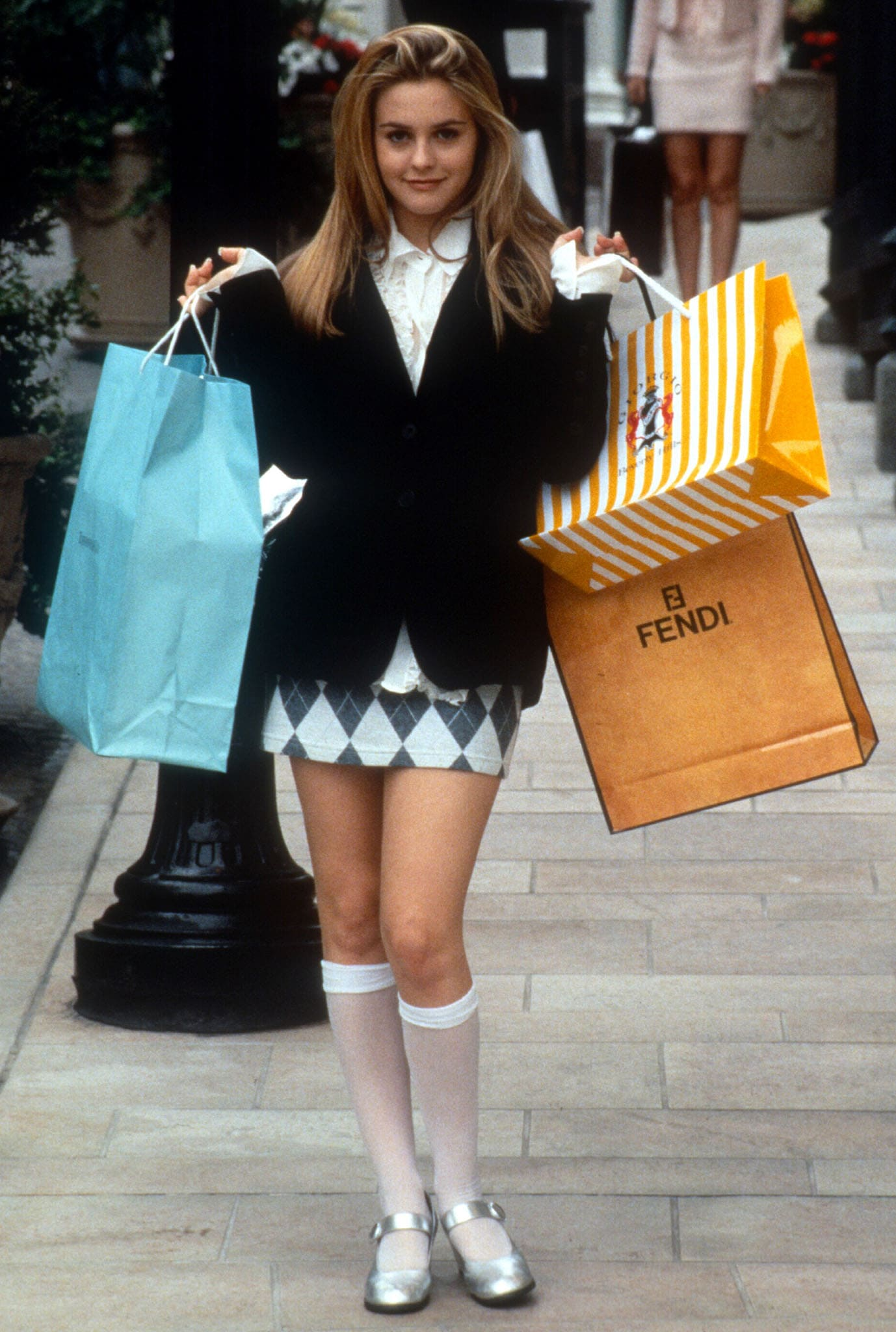 Alicia Silverstone wearing Mary Jane shoes with knee-high socks on the set of the 1995 movie Clueless