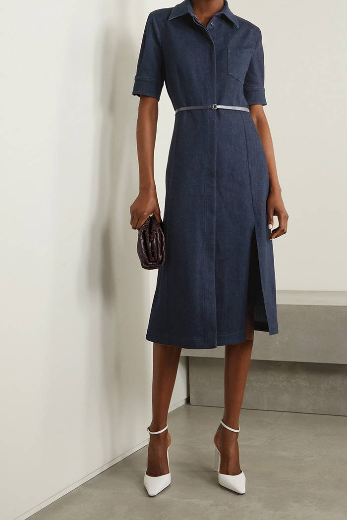 Conservative but chic, this belted denim midi dress has a collar and a modest slit at the knee-grazing hem
