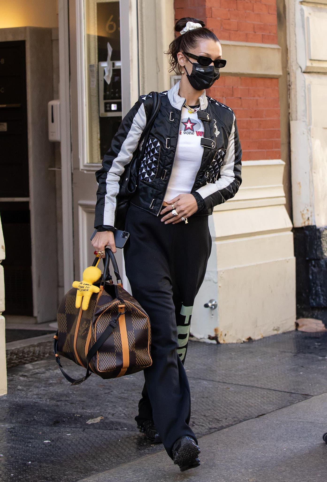 Bella Hadid teams her Nike Shox shoes with Foo and Foo sweatpants and a crop top