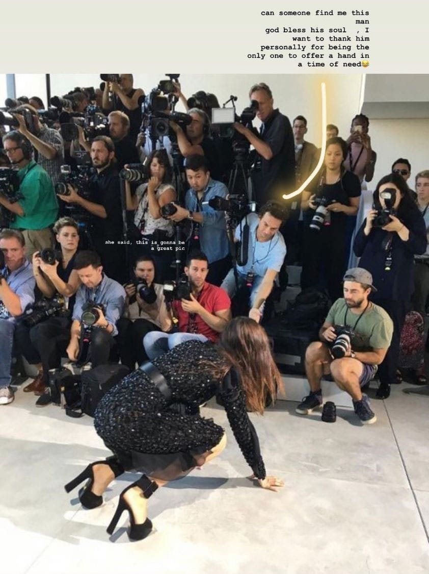 Bella Hadid is looking for the man who helped her get up after tumbling on the runway at Michael Kors' Spring 2017 show