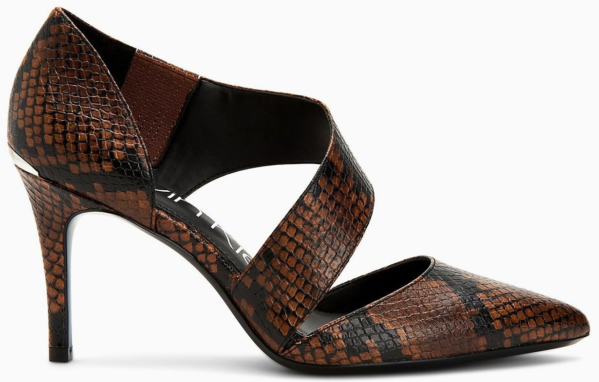 Add a sultry finish to your outfit with Calvin Klein's Gella snake heels with asymmetrical Mary Jane straps