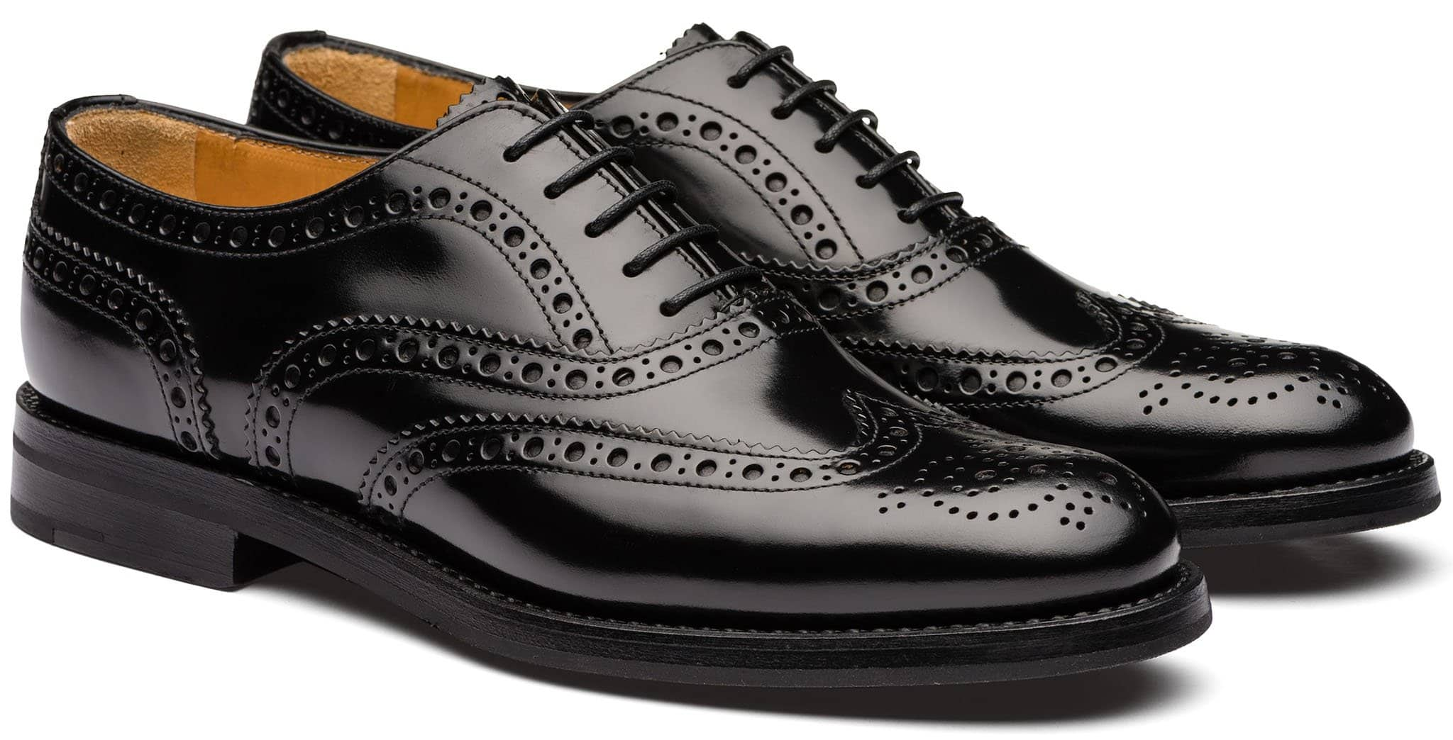 Gorgeous oxfords with a polished binder finish, brogue lace-up, and a wingtip design