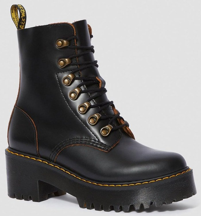 Feminine details like a slim silhouette and high, platform heel balance out the rugged and rebellious style of these contemporary leather combat boots