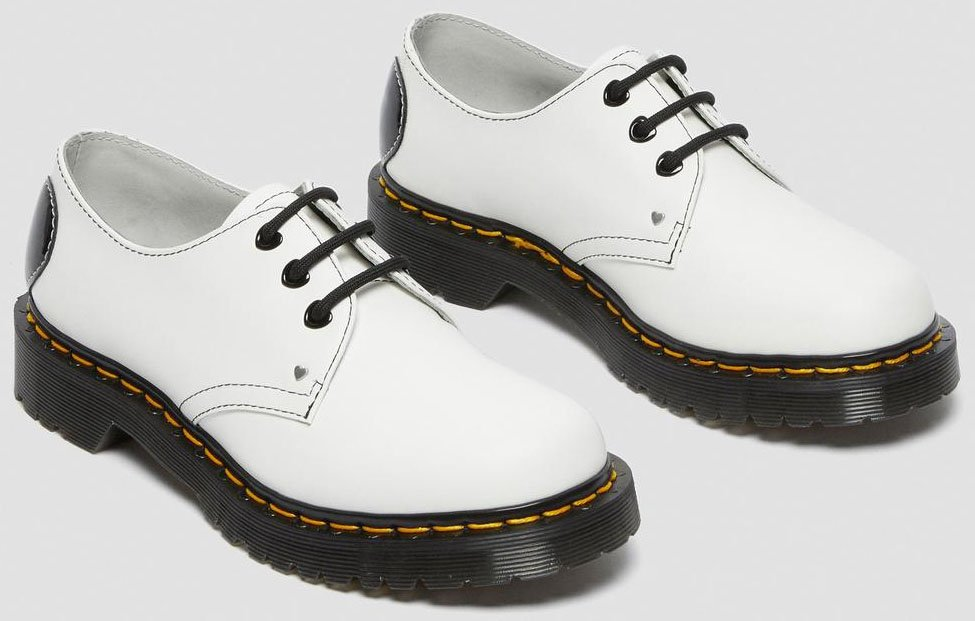 Built from a combination of Docs' classic smooth and patent lamper leathers for that sleek, glossy yet tough finish