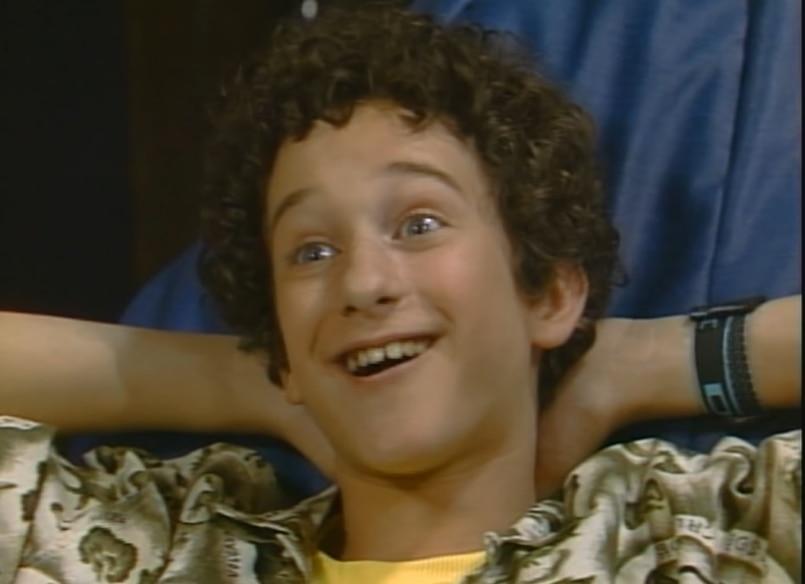 """Dustin Diamond as Zack Morris' (Mark-Paul Gosselaar) nerdy friend Samuel """"Screech"""" Powers on Saved by the Bell"""