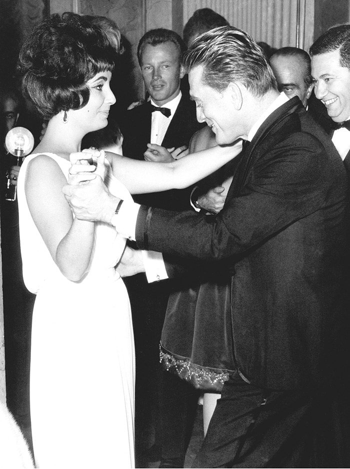 Elizabeth Taylor dancing with Kirk Douglas at the Spartacus premiere after-party in Rome in 1961