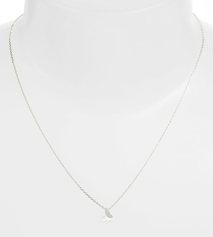 A delicate chain necklace with simple butterfly pendant from British jewelry brand Estella Bartlett