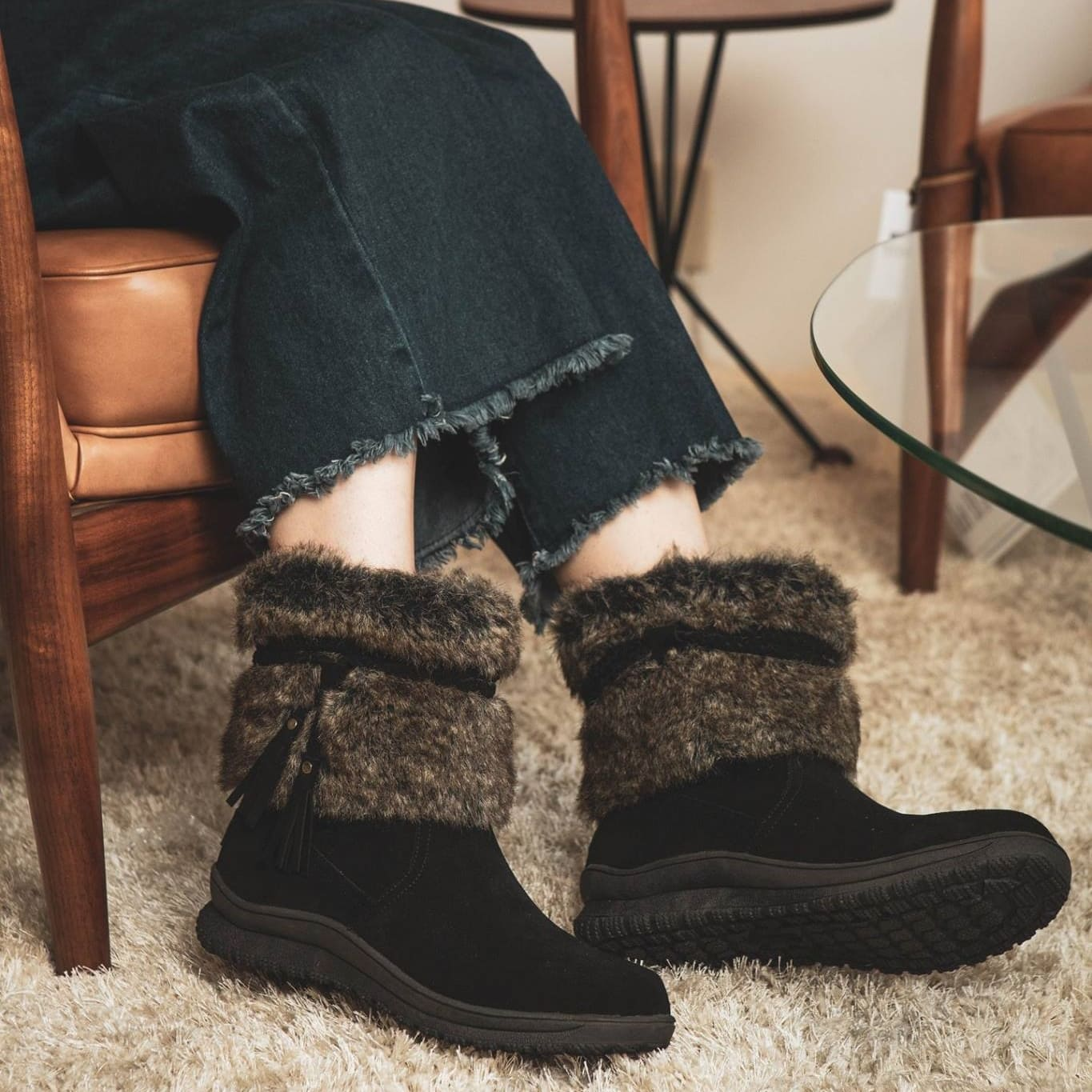 Tassel details and faux-fur trim add cozy-chic touches to this water-resistant pull-on boot