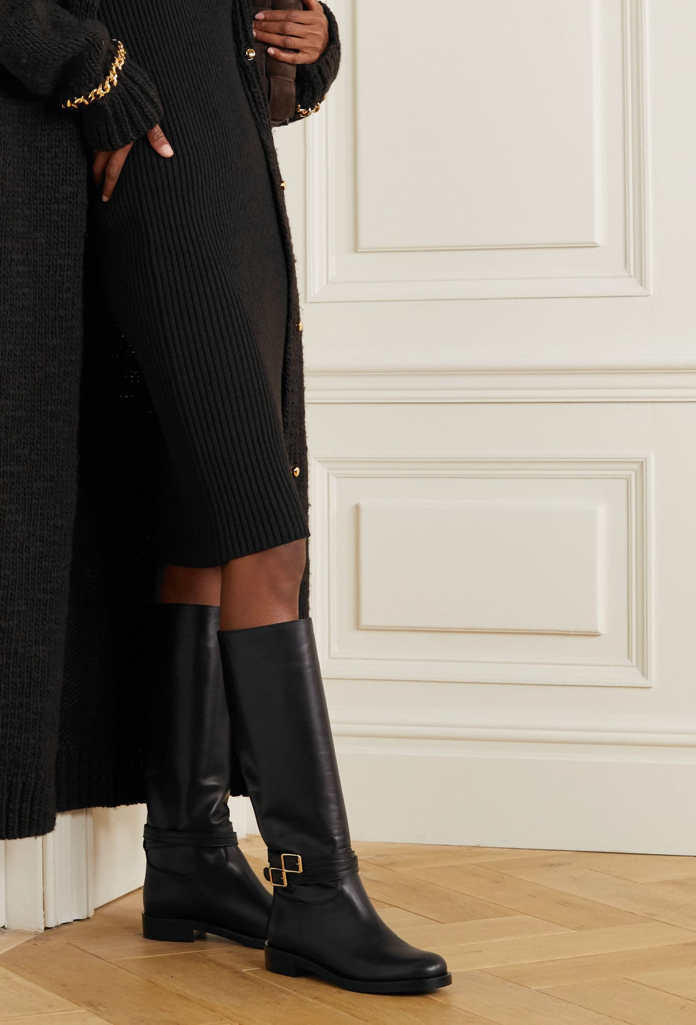 Create a chic monochrome look with black Gianvito Rossi knee boots, leggings, and sweater