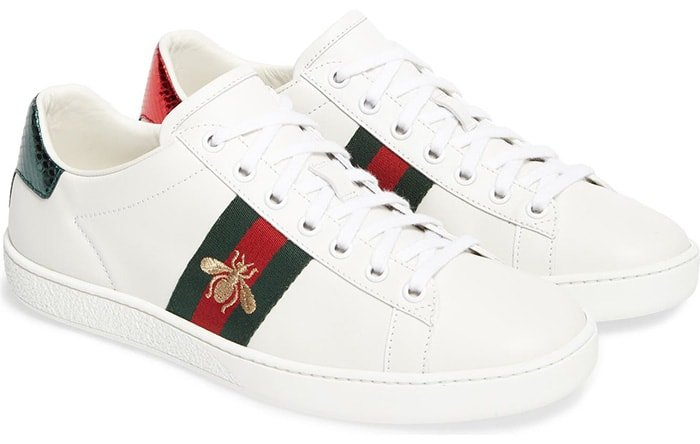 Golden bee embroidery and striped webbing bring iconic Gucci house codes to this sneaker while contrasting heel tabs reference the brand's official colors