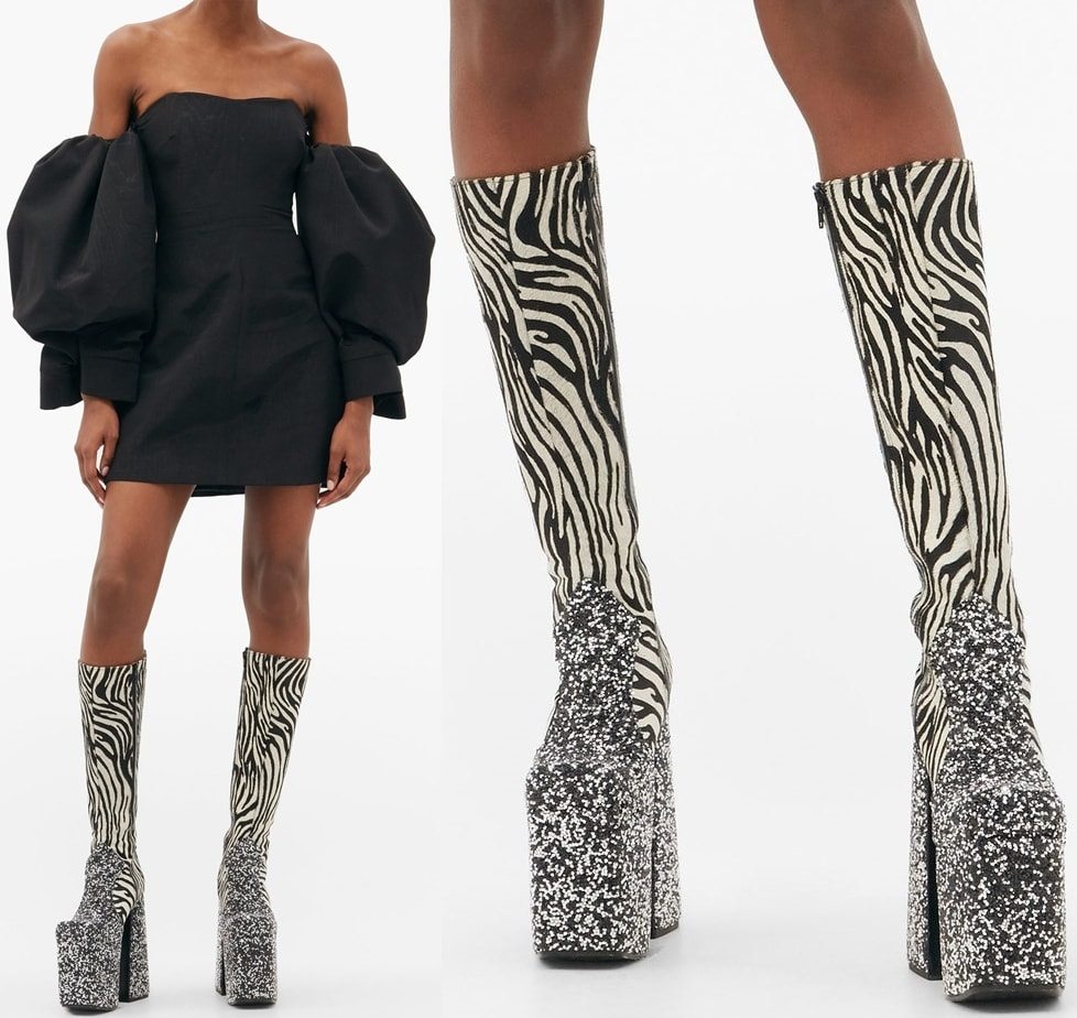 Black and white boots made from zebra-striped calf hair with a lace-up back and an exaggerated platform sole, then embellished with crystals
