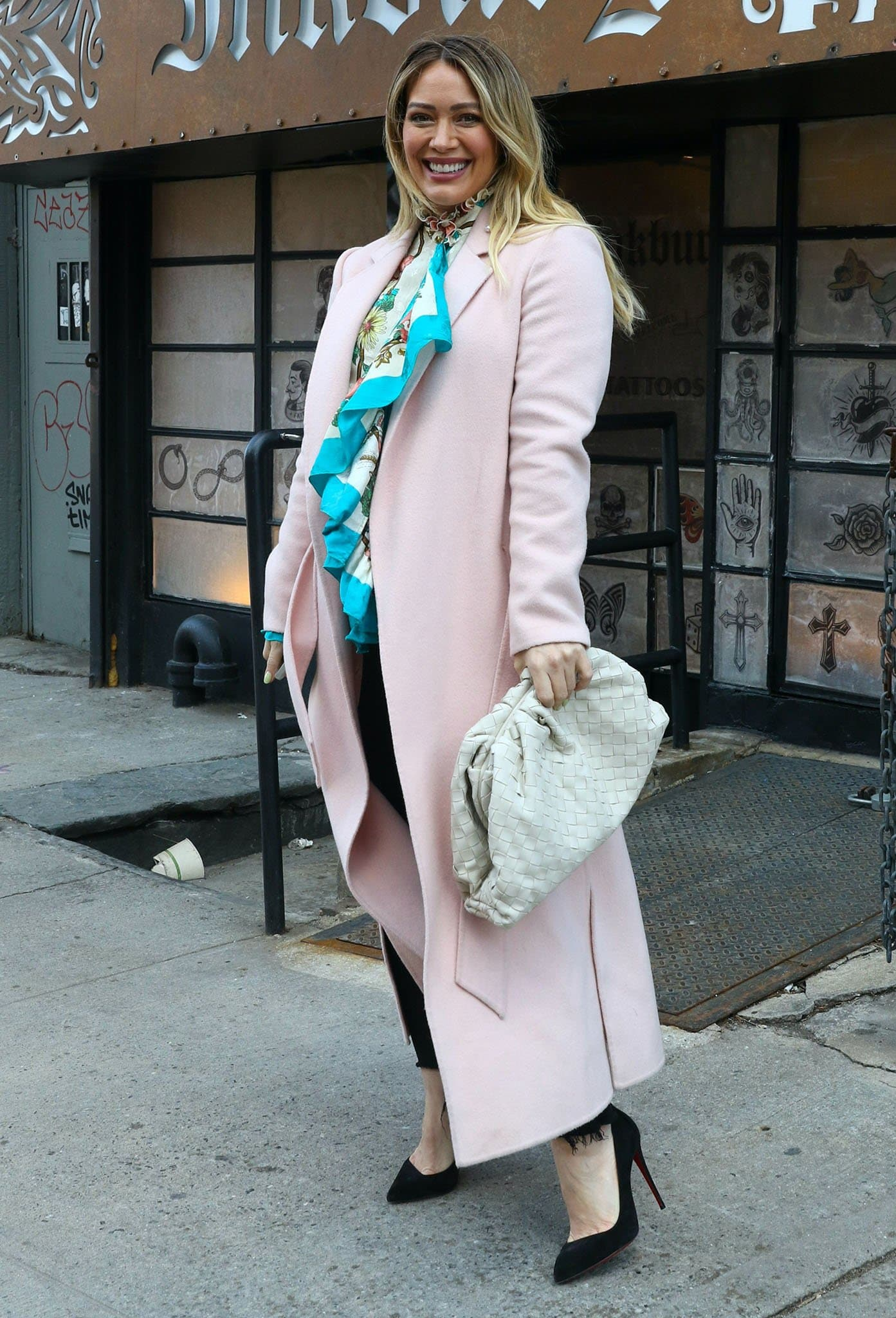 Hilary Duff in a feminine Gucci floral blouse and pink coat on the set of Younger season finale