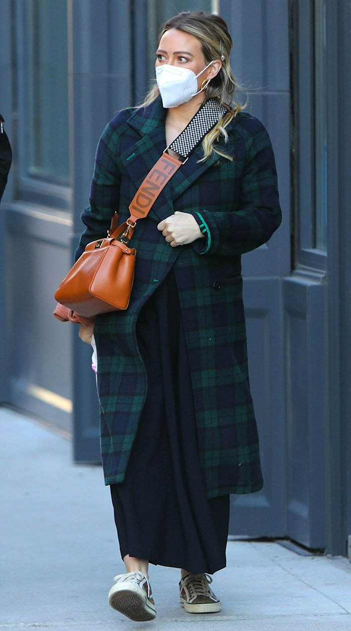 Hilary Duff wears blue-and-green plaid coat and black maxi dress on the Younger set