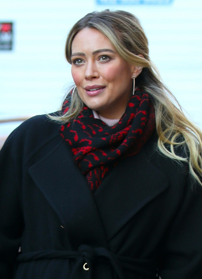 Hilary Duff wears a half-up hairstyle with pink blush and lipstick