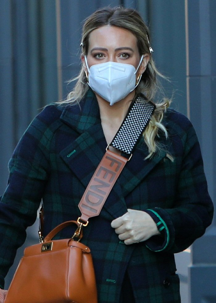 Hilary Duff carries her stuff in thick-strapped brown leather Fendi bag