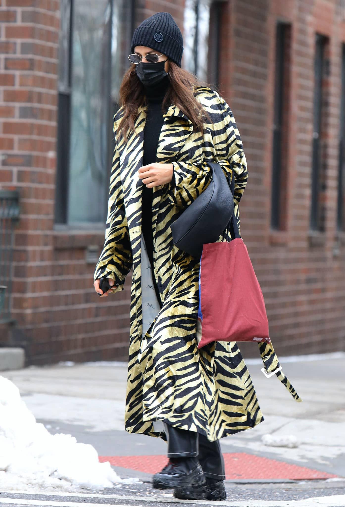 Irina Shayk runs errands in a tiger-print coat
