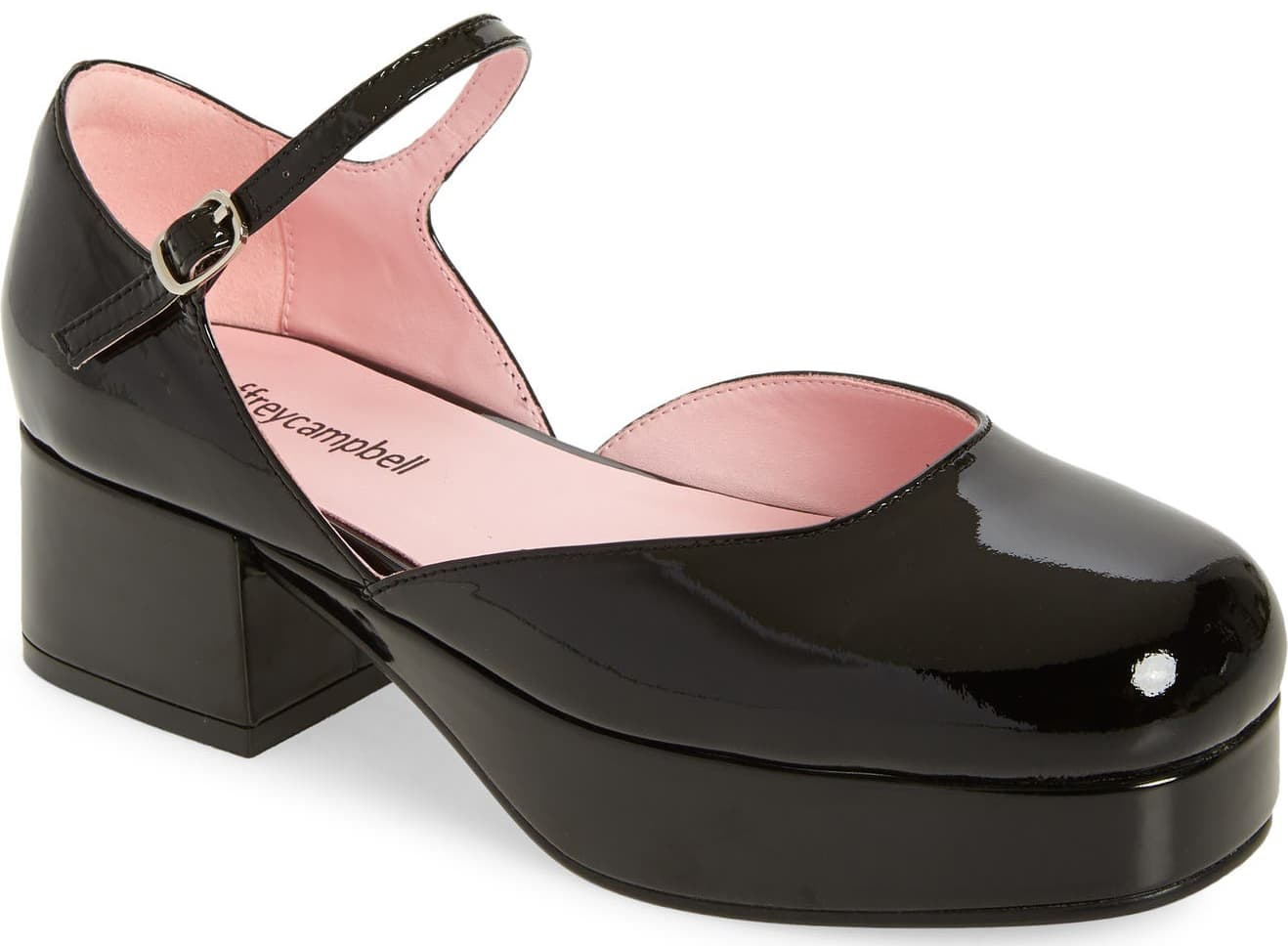 Glossy patent leather intensifies the appeal of a Mary Jane-inspired pump from Jeffrey Campbell set on a blocky heel