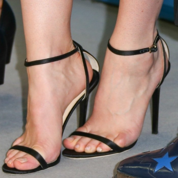 Lily James shows off her sexy size 9 (US) feet in black high heels