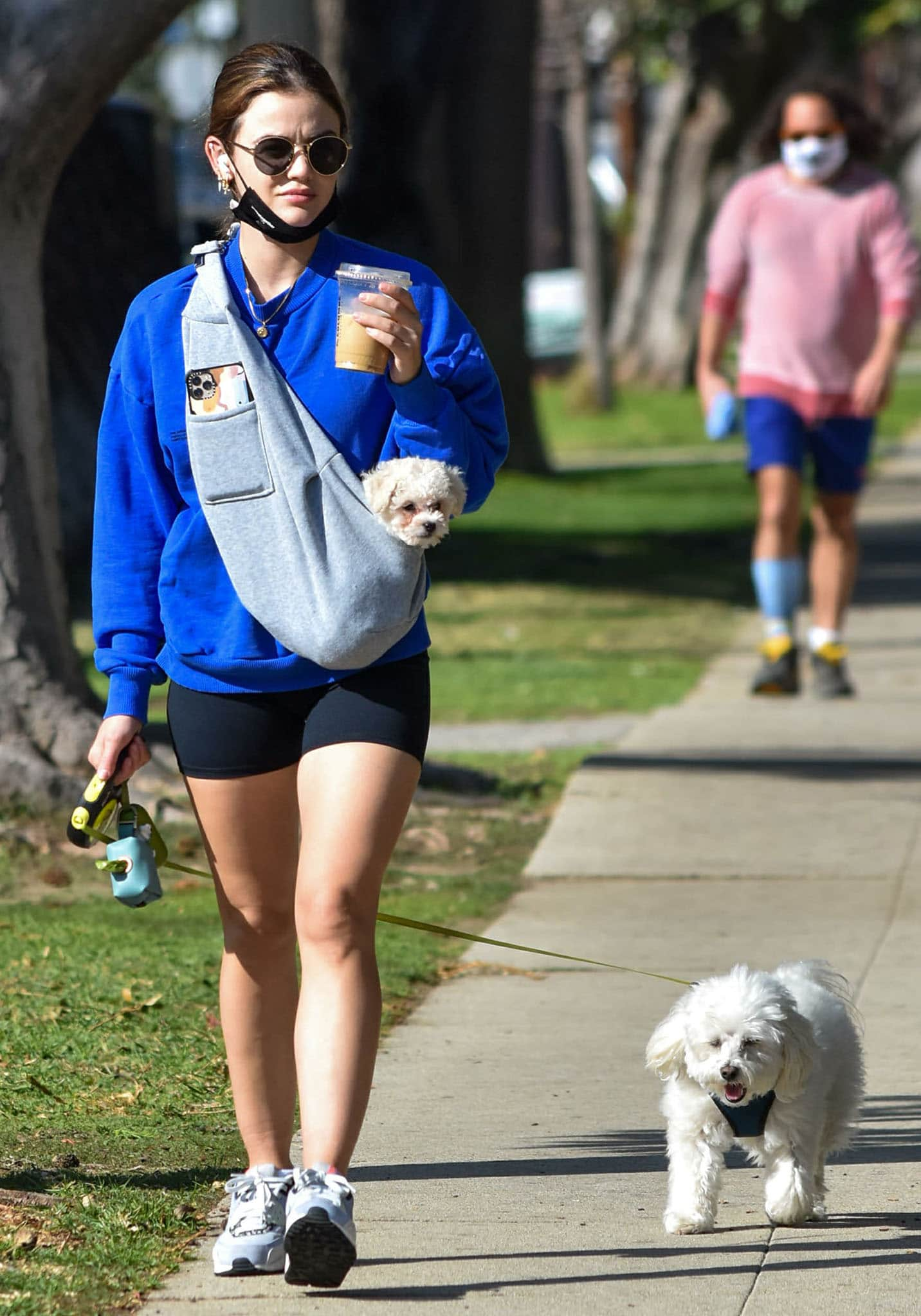 Fur mom Lucy Hale takes her dogs, Ethel and Elvis, out for a walk in Los Angeles on February 11, 2021