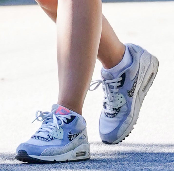 Lucy Hale pairs her chic and girly hiking outfit with Nike Air Max 90S sneakers