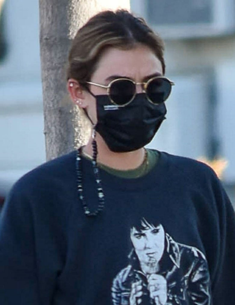 Lucy Hale wears her favorite Paradigm sunglasses and EvolveTogether face mask
