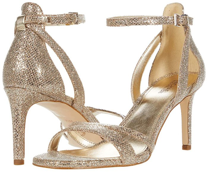 These high-heel sandals feature an open-toe front, a wrapped stiletto heel and a halo ankle strap