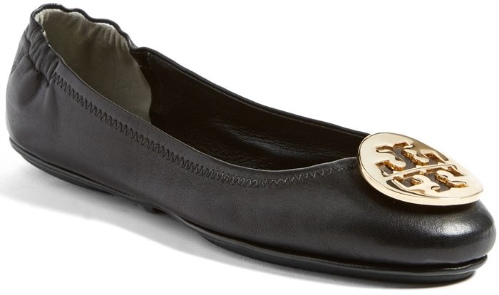 The iconic logo medallion tops the rounded toe of a cushy leather flat available in a wide choice of colors and spirit-lifting prints