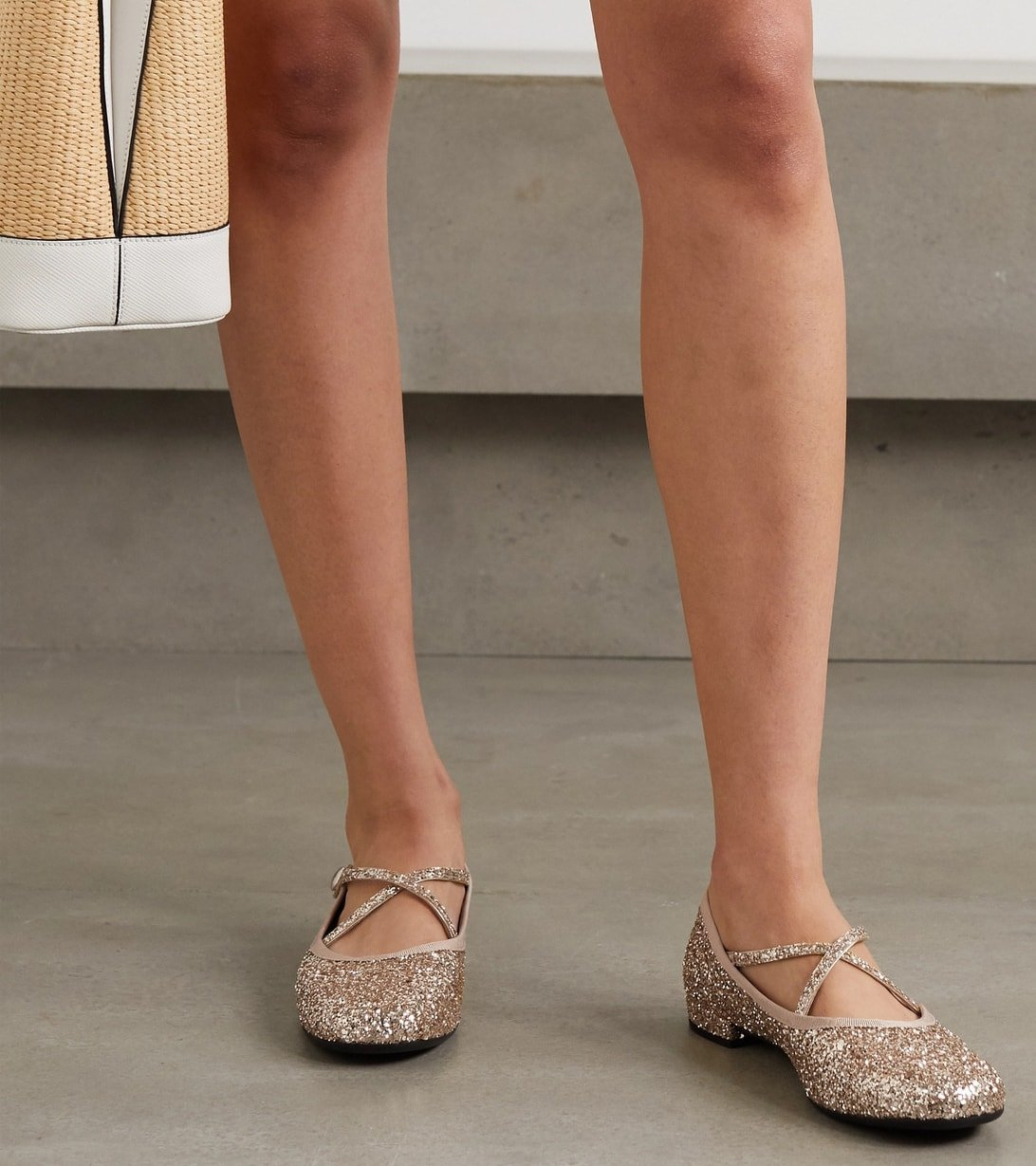 Made in Italy from glittered leather, these leather ballet flats from Miu Miu have elegant crossover straps and small stacked heels