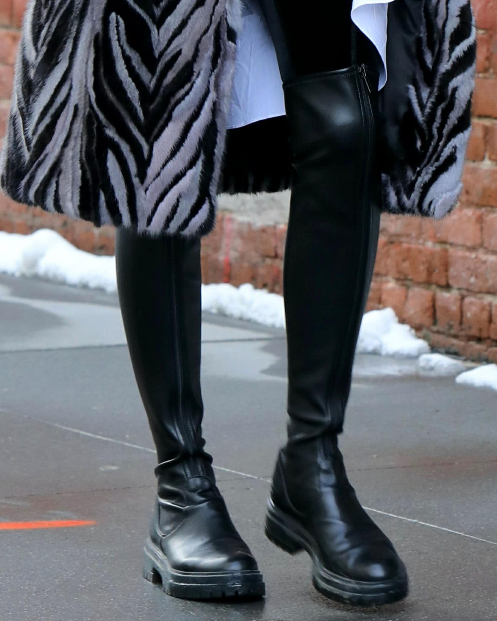 Olivia Palermo's Gianvito Rossi Marsden boots feature a zip fastening along the center front