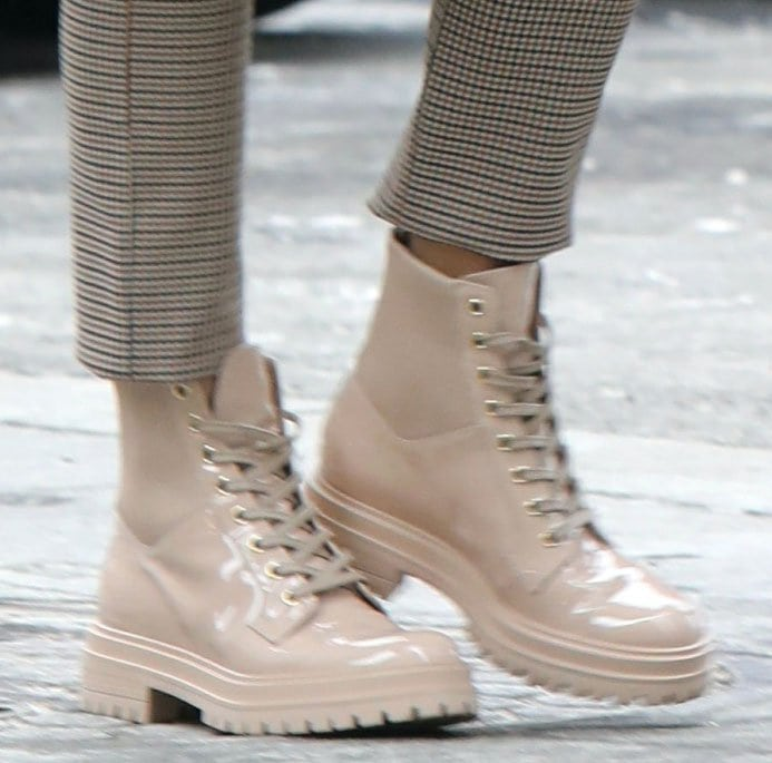 Olivia Palermo completes her stylish winter look with Gianvito Rossi beige combat boots