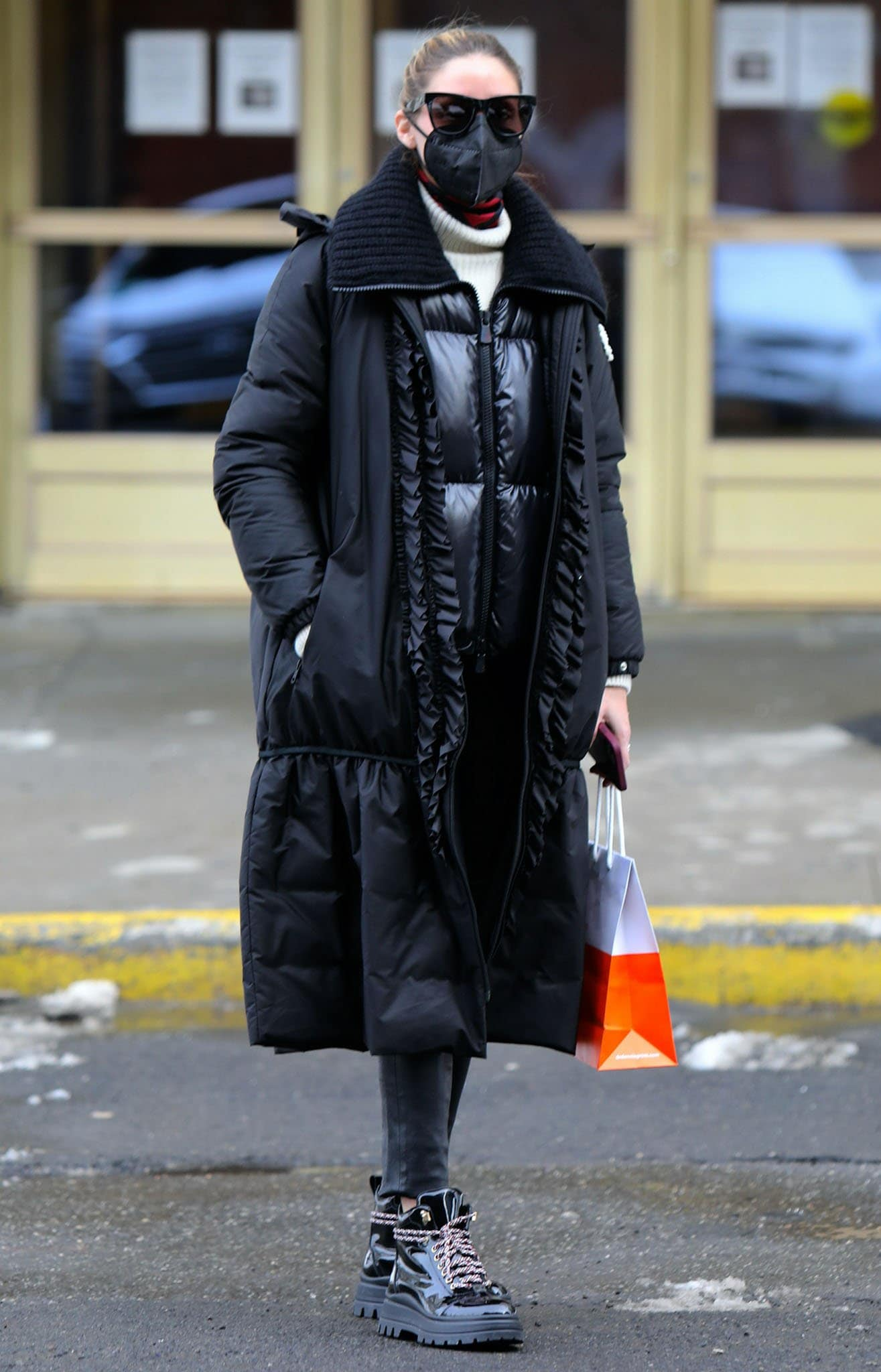 Olivia Palermo bundles up in Moncler Genius x Simone Rocha coat, vinyl jacket, and cream knit sweater