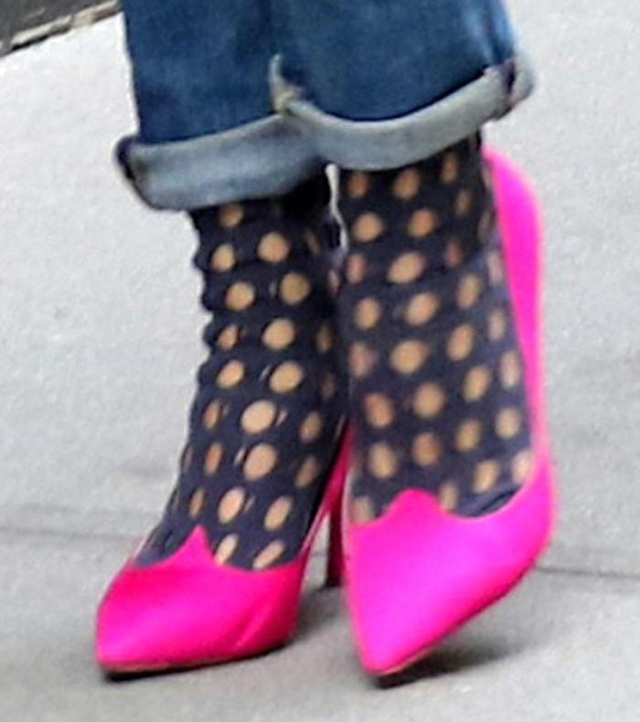 Olivia Palermo pairs cutout socks with hot pink Roger Vivier pumps