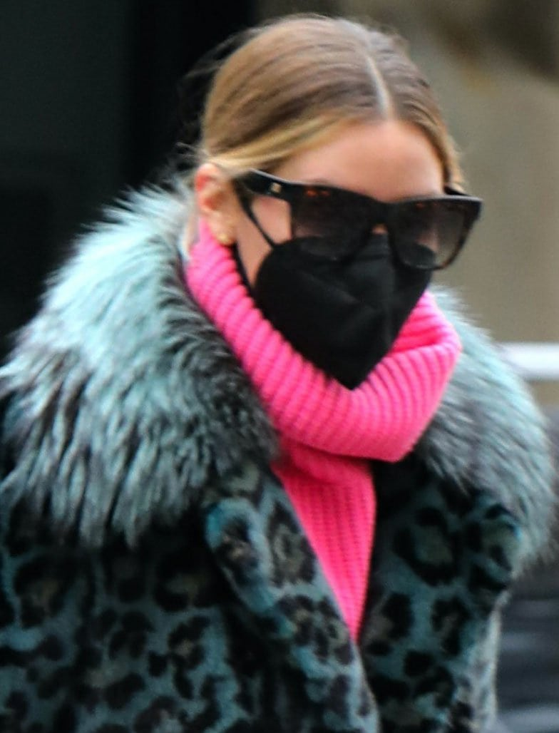 Olivia Palermo keeps a low profile with sunglasses and a face mask