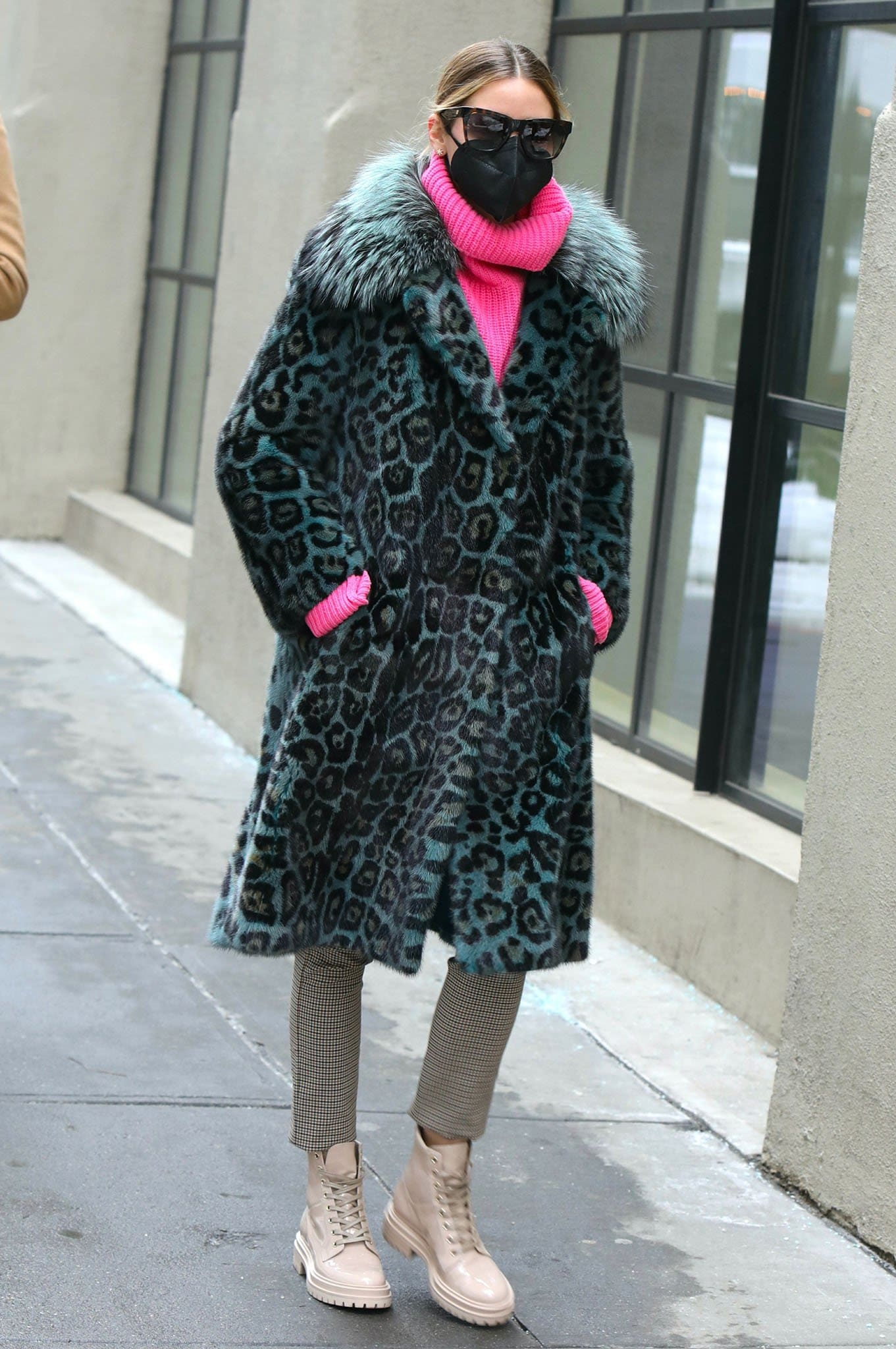 Olivia Palermo wears Cara Mila leopard mink coat over a chunky pink knit sweater