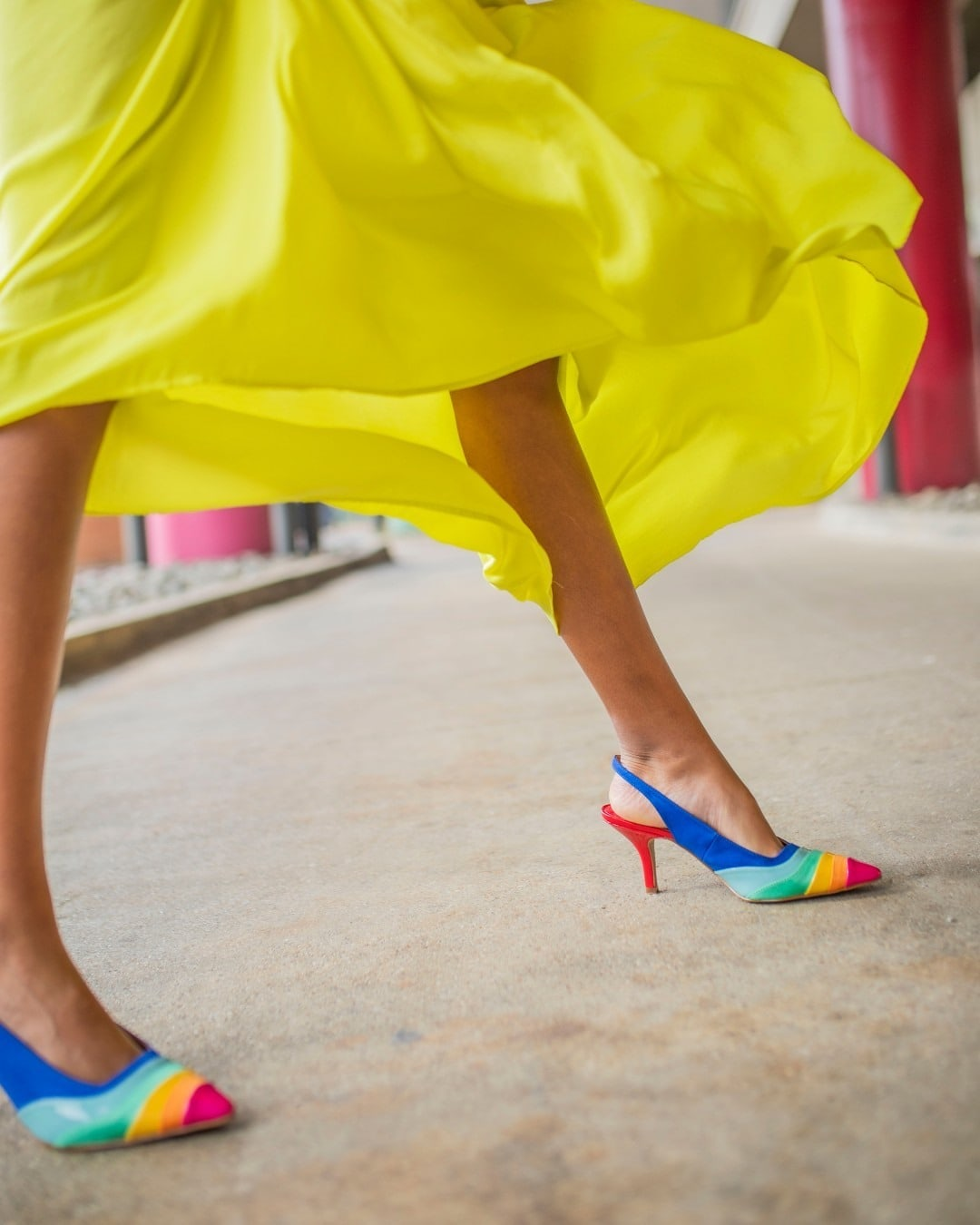 Eye-catching rainbow stripes add a vibrant touch to a pointy-toe sling-back pump that's made even more enticing with its cushy, memory foam footbed