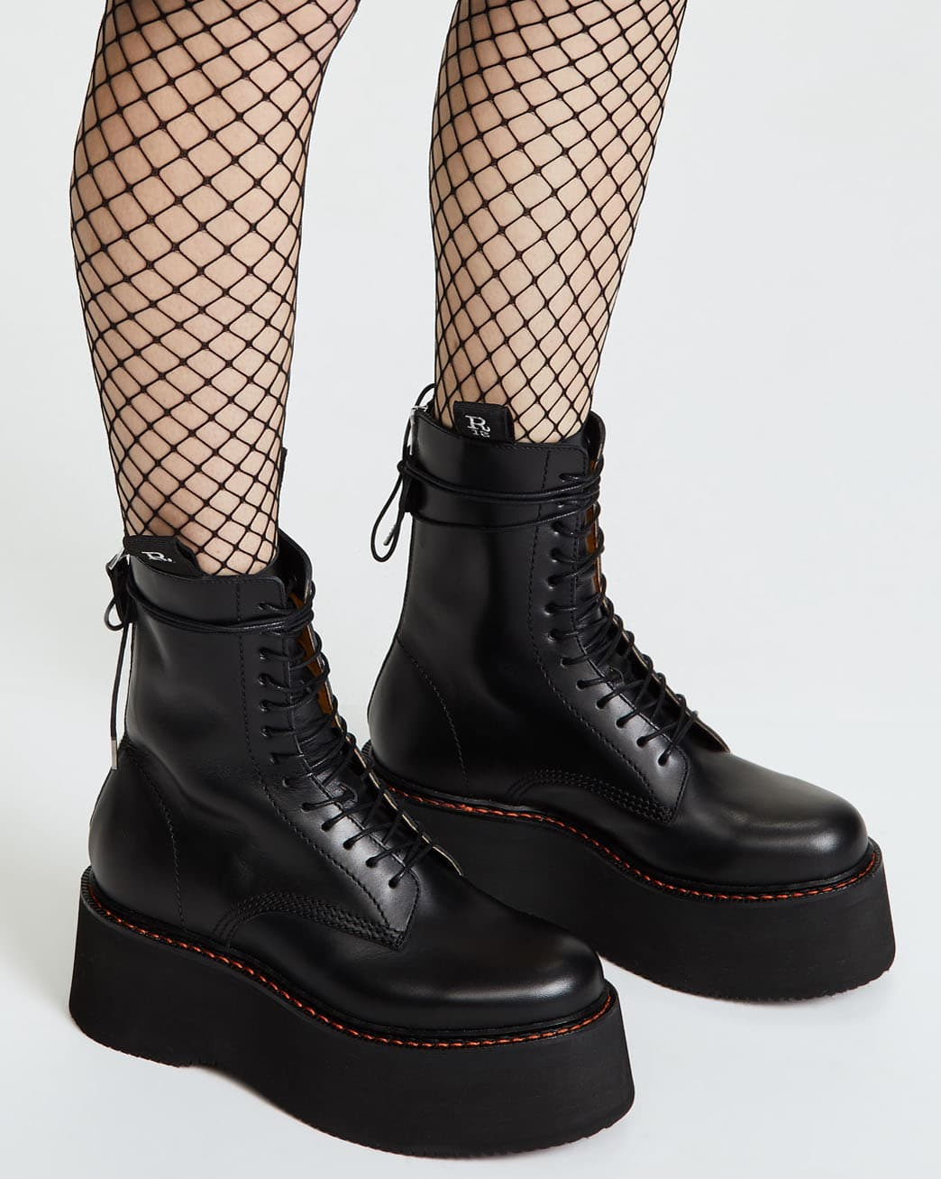 Elevate your rock-chick rebellious look with the R13 combat boots with 2.75-inch platforms