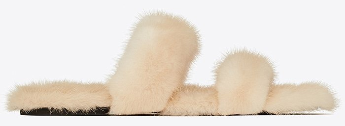 Finnish mink fur wraps the dual straps and sumptuously lines the footbed of a slide sandal that's both decadent and incredibly versatile