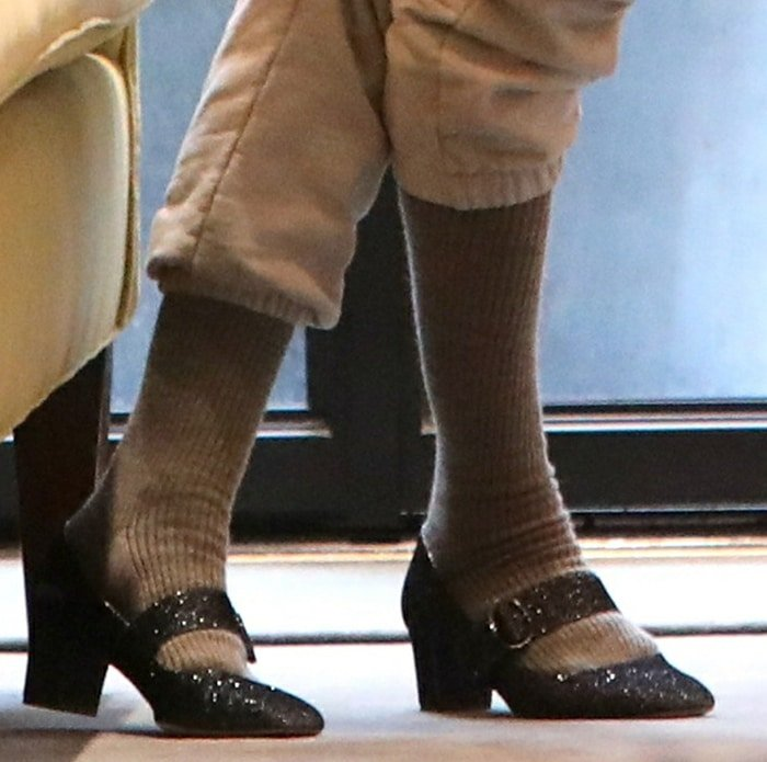 Sarah Jessica Parker teams her sweats with knee-high socks and glittery Mary Jane pumps