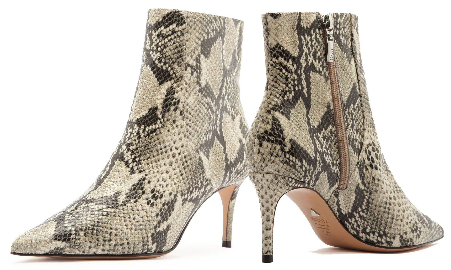 Wear a pair of Schutz Bette snake-print ankle boots with leggings for a stylish winter date night
