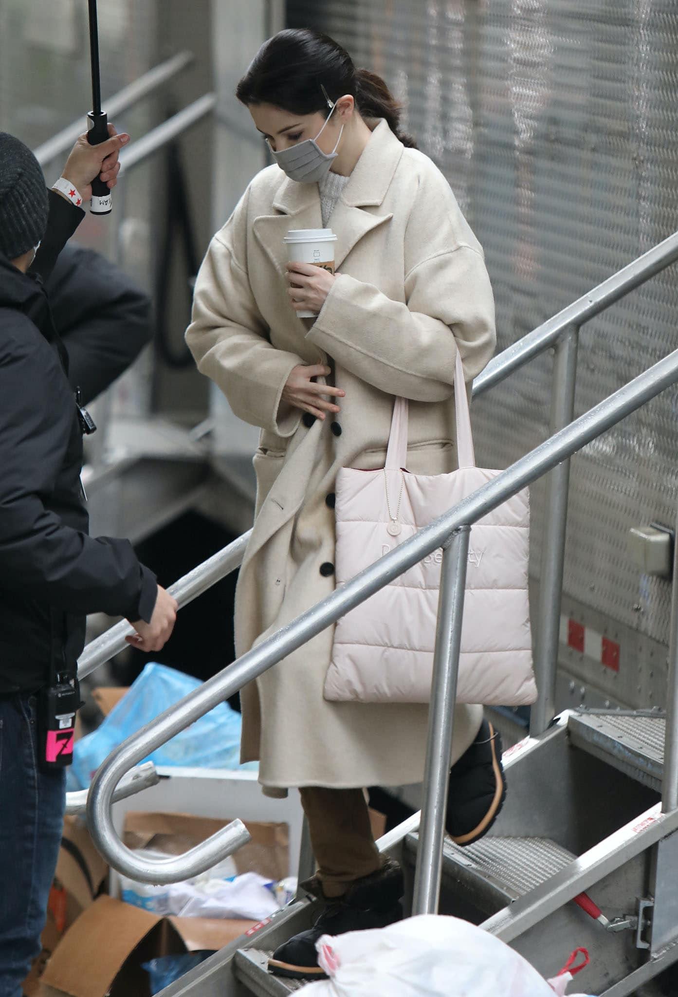 Selena Gomez bundles up in Free People wool coat and fleece sweatpants