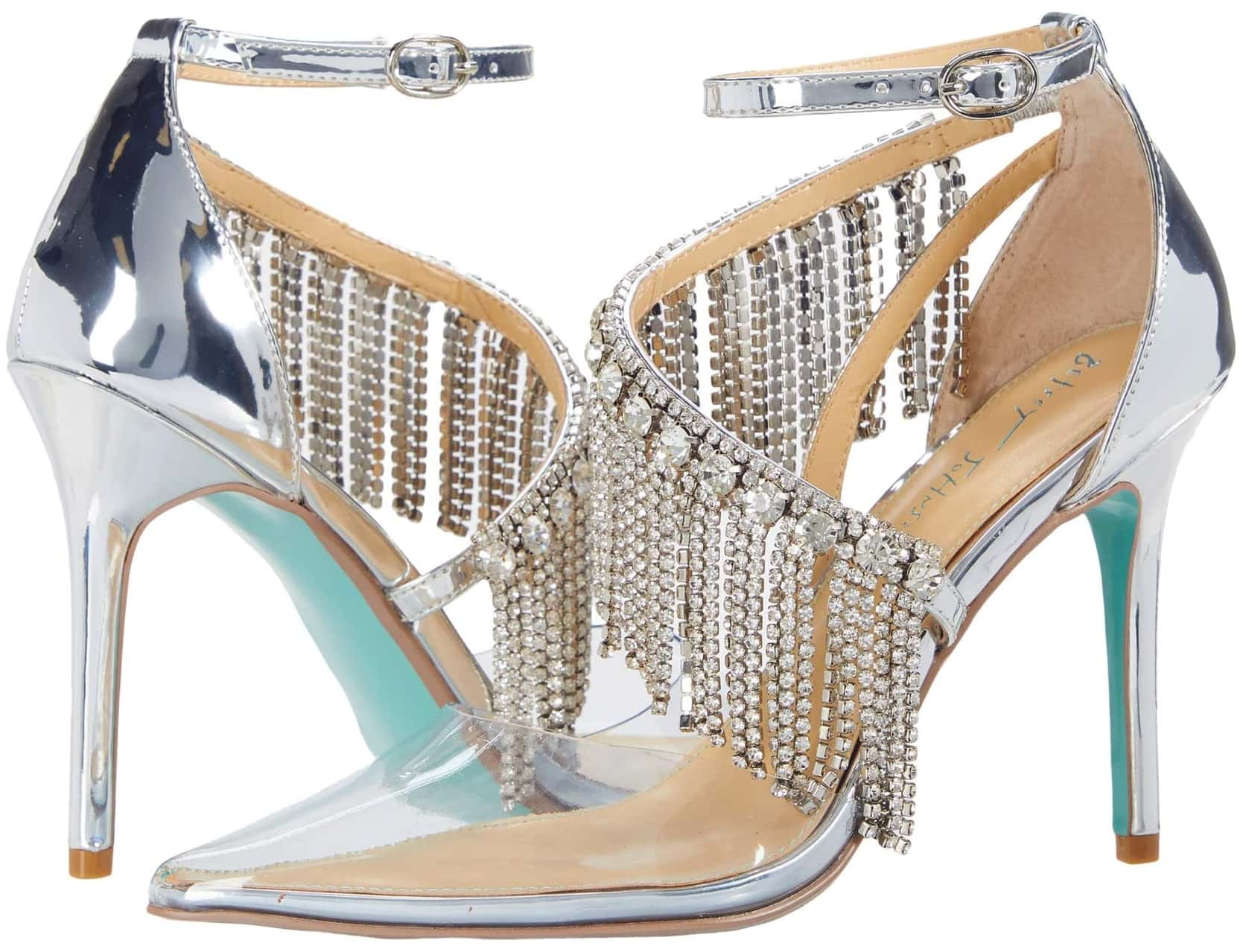 A heavily embellished cascading row of rhinestone fringe adds a dramatic finish to the silver Maze ankle strap pump