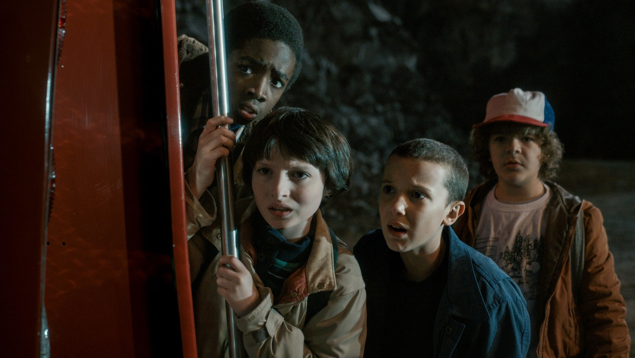 Caleb McLaughlin, Finn Wolfhard, Millie Bobby Brown, and Gaten Matarazzo in the science fiction horror mystery-thriller streaming television series Stranger Things