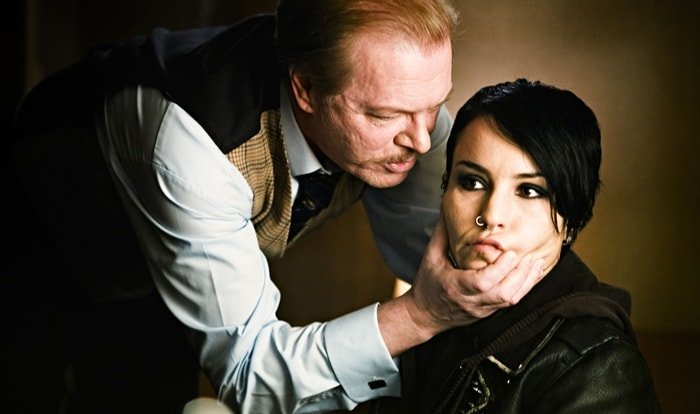 Peter Andersson as Nils Erik Bjurman and Noomi Rapace as Lisbeth Salander in The Girl Who Played with Fire