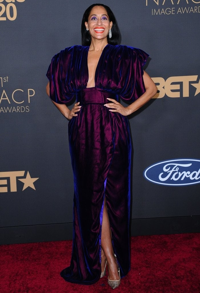 Tracee Ellis Ross wears a Christopher John Rogers eggplant velvet dress at the 51st NAACP Image Awards