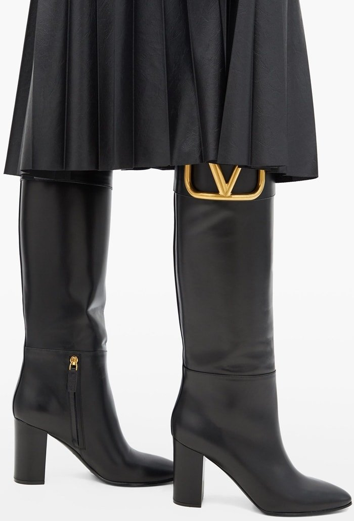 Valentino Garavani's black Supervee boots are crafted in Italy from butter-soft leather to a knee-high profile that rests on a block heel