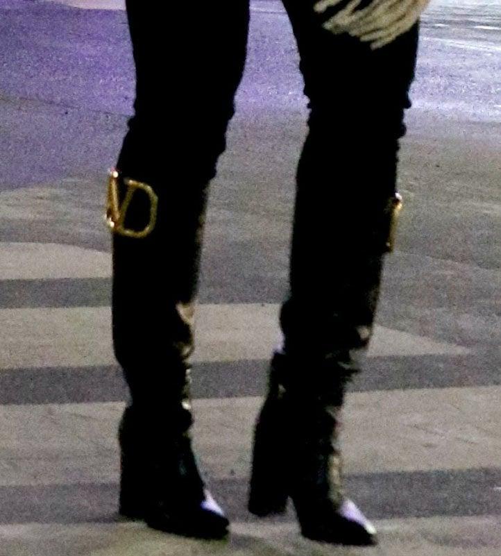 Hilary Duff tucks her black pants into a pair of Valentino Garavani Supervee knee-high boots