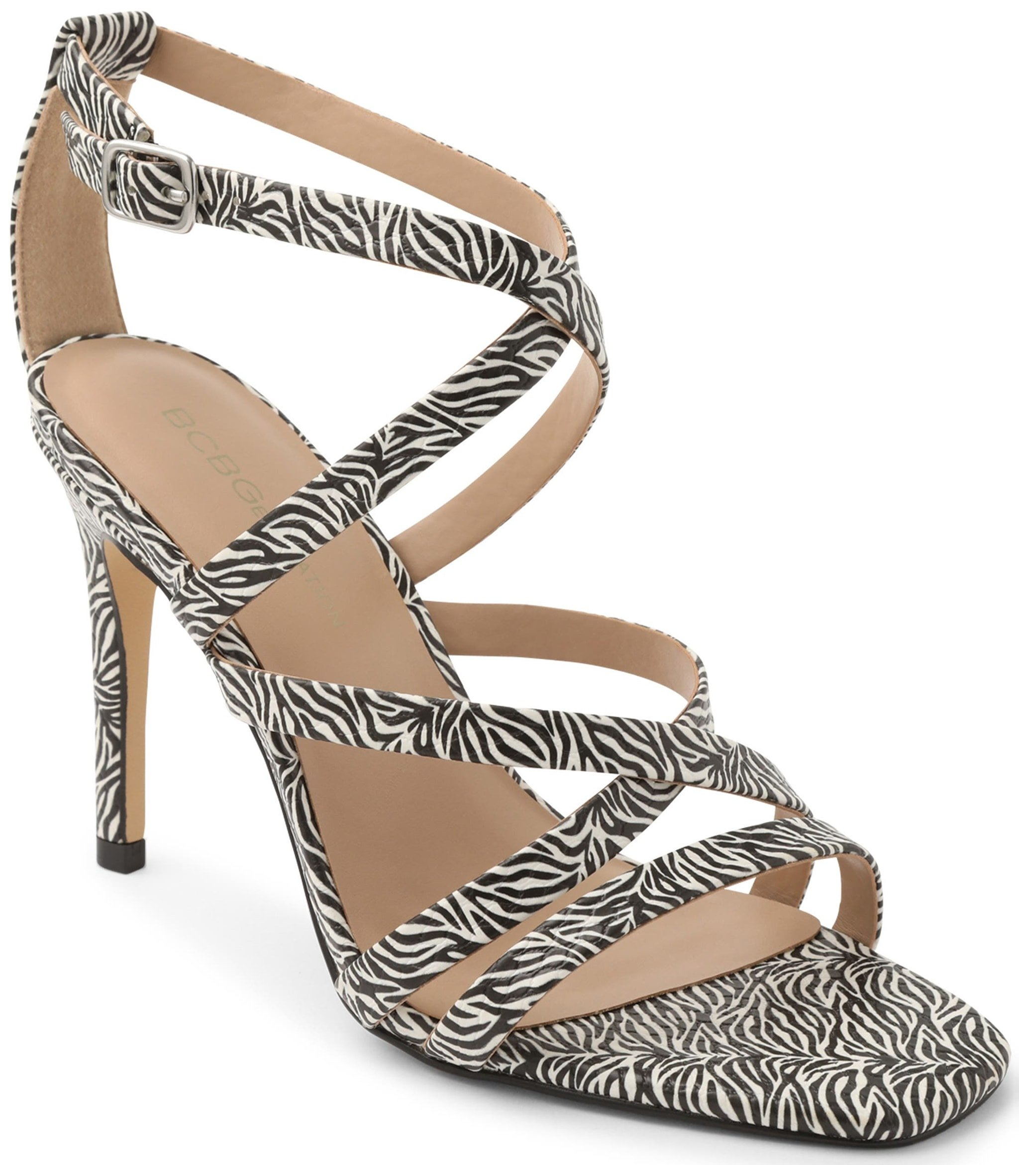 Slender crisscrossing straps and a stiletto heel elevate your entire wardrobe in these zebra print sandals from BCBGeneration